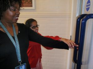 Photo demonstrating how to safely guide a vision impaired when opening doors