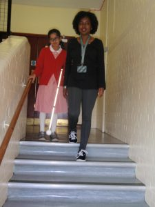 Photo demonstrating how to guide a vision impaired person safely when using stairs